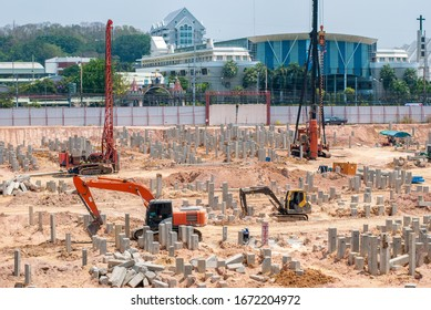 Outdoor construction site with piles and cranes