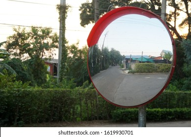 Outdoor convex mirrors. Traffic curved glass. Large convex mirror on the road to improve visibility. Convex mirrors for roadside safety.
