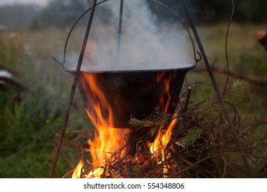 Outdoor cooking on campfire