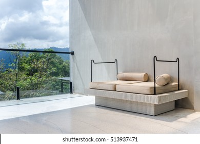 outdoor cozy sofa furniture on terrace with shadow shade and window light on left hand