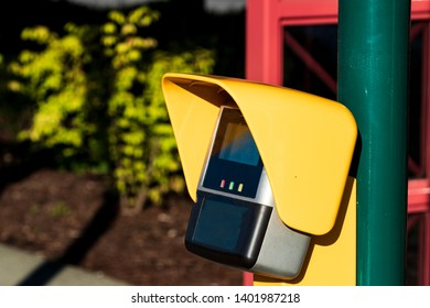 Outdoor credit card payment terminal in daylight