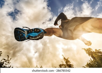Outdoor cross-country running low angle view under runner concept for exercising, fitness and healthy lifestyle