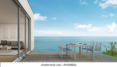 Outdoor dining of beach house with sea view in modern design - 3d rendering
