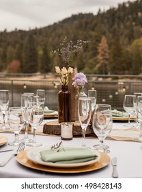 outdoor dinning table setup old bottles over looking the lake