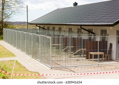 Outdoor dog kennels outside a building.