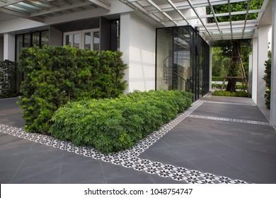 outdoor empty corridor with garden in the modern office building.