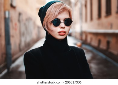 Outdoor fashion closeup portrait of young pretty woman