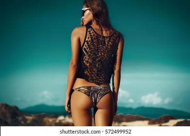 Outdoor fashion female model portrait. Beautiful chic girl with slim figure