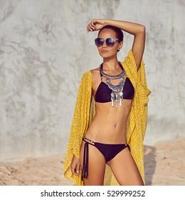 Outdoor fashion portrait of beautiful female model posing outdoor