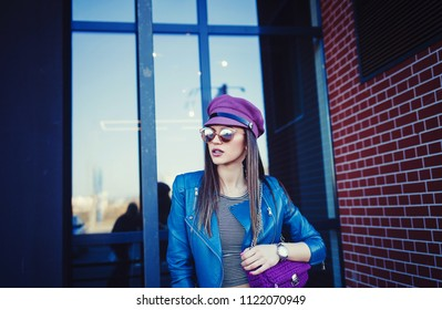 Outdoor fashion portrait of glamour sensual young stylish lady wearing trendy fall outfit , black hat, leather jacket and bag.