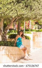 Outdoor fashion portrait summer style of young beautiful woman fresh face smiling on tropic island having fun on vacation in blue dress