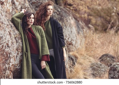 Outdoor fashion portrait of two beautiful stylish ladies in trendy and fashion cardigans. Casual look. Street style.