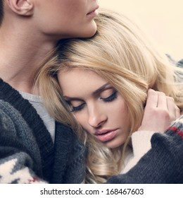outdoor fashion portrait of young sensual couple in cold winter weather. love and kiss