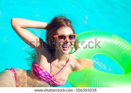 fecf777230c Outdoor fashion portrait of young sexy woman with playful ponytails and  perfect sportive body
