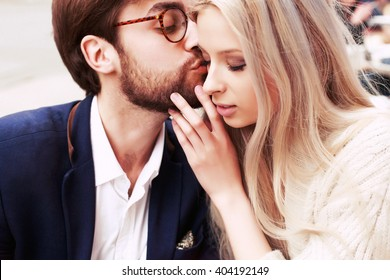 Outdoor fashion sensual beautiful couple in love closeup outdoor portrait blonde woman and hipster stylish man
