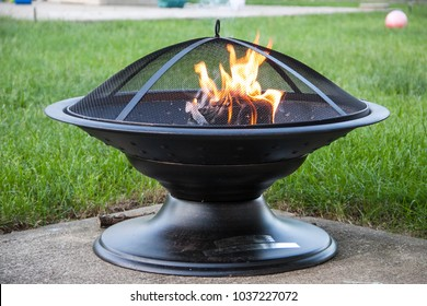 Outdoor firepit with lit fire