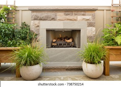 An outdoor fireplace on a patio.
