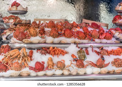 Outdoor Fish Market with Crab and Shrimp on ice in Paris France