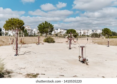 Outdoor fitness equipment on the sandy beach in public park for healthy active lifestyle, nobody. Torrevieja resort city, Province of Alicante, Costa Blanca, Spain