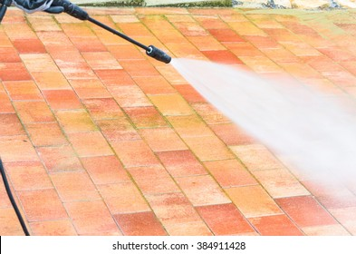Outdoor floor cleaning and building cleaning with high pressure water jet.
