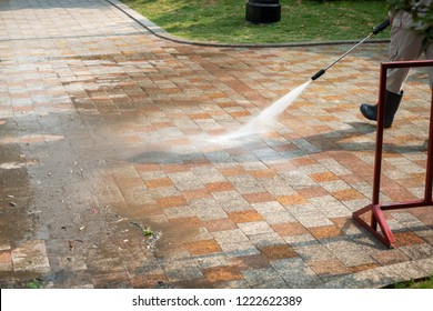 Outdoor floor cleaning with a pressure water jet on street