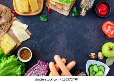 Outdoor food, Various food on the table sausages, sauces, ketchup, greens, salad, bread, vegetables, cheese (fast food snack for the company, picnic) menu concept background. top view. copy space