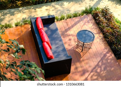 Outdoor furniture in green garden with with chairs, outdoor furniture rattan armchairs and table on terrace, for relax time.