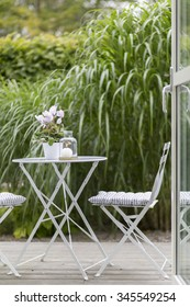 Outdoor furniture on green patio