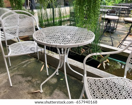 Zen Garden Furniture Throughout Outdoor Furniture White Steel Chairs And Table In The Zen Garden Landscape Furniture White Steel Chairs Table Stock Photo edit Now