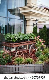 outdoor garden décor, wooden cart with flowers