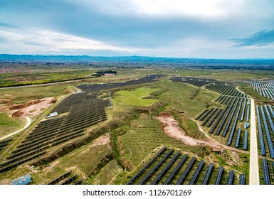 Outdoor geological features and solar photovoltaic panels