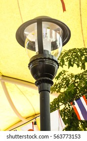 Outdoor glass and metal decorative lamp