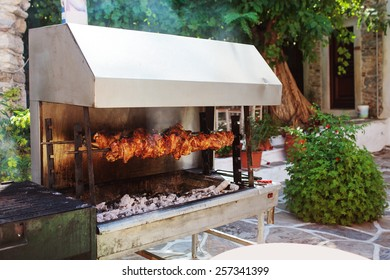 Outdoor grill with roasted meat in the village of Halki.  Naxos, Greece.
