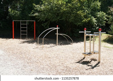 outdoor gym with fitness equipment and exercise machines in public park in Germany