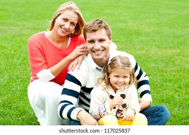Outdoor happy caucasian family relaxing. Bright sunny day
