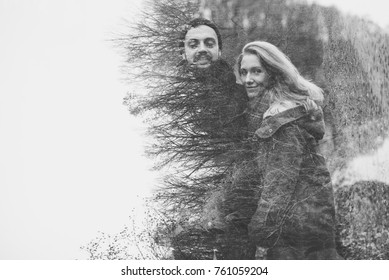 Outdoor happy couple in love posing in cold weather. Young boy and girl having fun outdoor Double exposure.