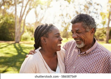 Outdoor Head And Shoulders Shot Of Mature Couple In Park