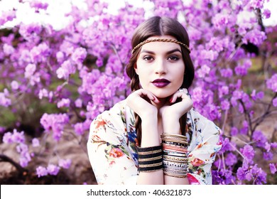 Outdoor high fashion portrait of young woman model, posing with trendy accessories and boho chic clothes. Fashion blogger outfit close up. Street style concept photo toned style instagram filters