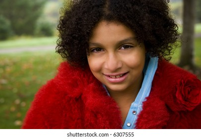 outdoor image of a beautiful child in a red coat