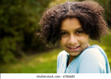 outdoor image of this pretty biracial girl