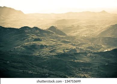 Outdoor Italian gold hills landscape at sunset. Horizontal shot