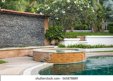 Outdoor jacuzzi and swimming pool in the garden