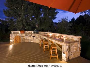 outdoor kitchen on backyard at dusk