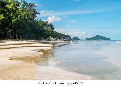 Outdoor landscape of beautiful tropical sea beach with sea water in Khao Sam Roi Yot National Park, Thailand. Beautiful landscape of exotic white sand sea beach and palm trees Southeast Asia, Thailand