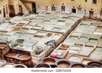The outdoor leather tannery in Fes in Morocco consists of a number of different pits that are filled with different chemicals to tan and dye leather.