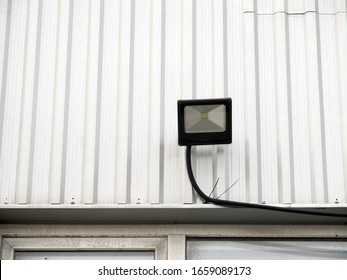 Outdoor LED spotlight on wall background