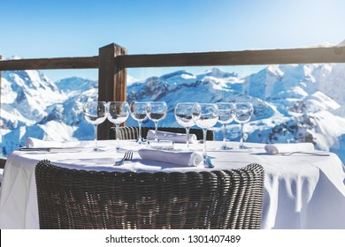outdoor luxury restaurant table with beautiful landscape view in alpine mountains