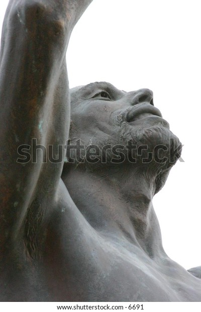 outdoor male statue reaching skyward