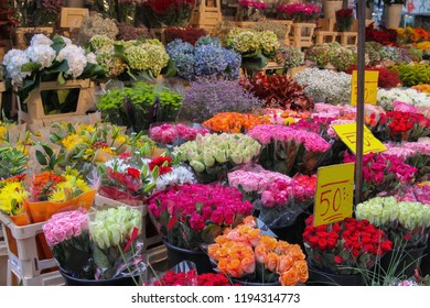 Outdoor market florist selling a variety of colorful flowers like roses, daisies, and tulips  in Stockholm, Sweden