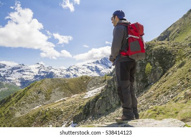 The Outdoor Men. Caucasian Hiker with Large Backpack Enjoying Scenic Trail in the mountains